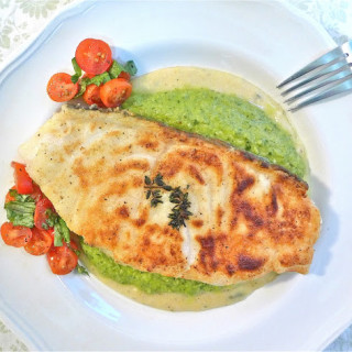 Pan-Fried Chilean Sea Bass With Creamy Polenta & Pea Sauce